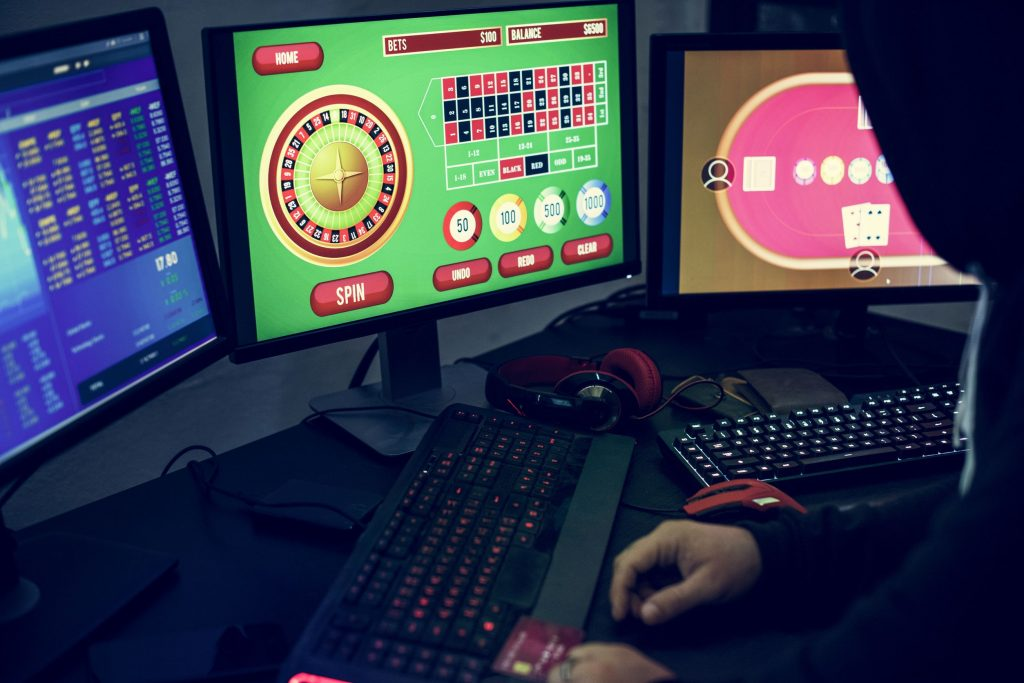 106350768 - playing gambling online on computer laptop